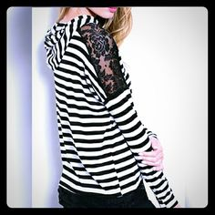 Stripes & lace hooded shirt L Black and white striped hooded tee with lace shoulders and lace around the bottom.    medium and large left.  This listing is for the large.  Anyone else addicted to stripes?! boutique Tops Tees - Long Sleeve