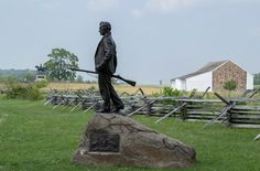 The John Burns statue can be seen with the General Reynolds statue and the McPherson Barn in the background.