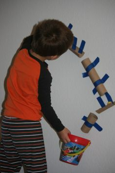Such a fun activity with things you already have at home!  Less expensive than PVC pipes but just as fun!  www.playwithyourfamily.com