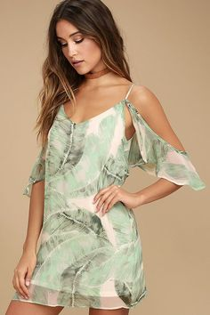There are only good vibes in the Radiate Positivity Sage Green Print Off-the-Shoulder Dress! Breezy chiffon, with a sage green and ivory palm print, falls from adjustable straps into a V-neck and ruffled off-the-shoulder sleeves. Shift silhouette with flounce at back.