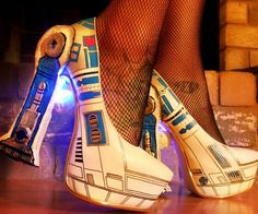 Beep boop beep bop - these R2-D2 LED pumps are definitely the party shoes you've been searching for. They're painted by hand, customized with cool droid-like accents and contain embedded LED modules that cycle between 8 vibrant color combinations.