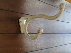 This very sturdy double style hook can be used to hold your coats in an entry way or towels in a bathroom. Projects 6 1/2 from the wall making it