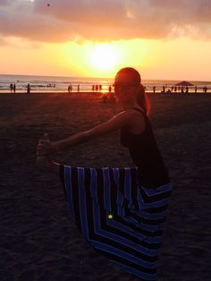 Yoga at the beach sunset Bali