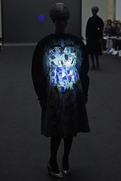 These looks from Anrealage changed colors and patterns upon contact with the runway's ultraviolet spotlights. [Photo by Giovanni Giannoni]