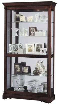 Found it at Clockway.com - Howard Miller Curio Cabinet - CHM1494
