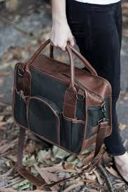 100% organic waxed 18 oz canvas. Heavy-duty brass hardware and zipper. 6 exterior pockets, 3 interior pockets. United By Blue's removable, adjustable twill strap has been updated to a removable, adjustable leather strap. Reinforced leather bottom to prevent wear and tear.