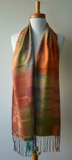 Looks like a dyed warp, with an uneven block twill....lovely autumn colorway