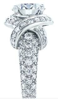 Jean Schlumberger Engagement Ring    Fluid and enchanting, Tiffany master designer Jean Schlumberger's signature ring features a round brilliant diamond center stone wrapped in pavé diamonds.   http://www.tiffany.com/Engagement/Item.aspx?groupSku=GRP10022=23984911