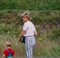 Princess Diana and Prince Harry-- this photo is so familiar to the one with Prince George and his grandma Carole.
