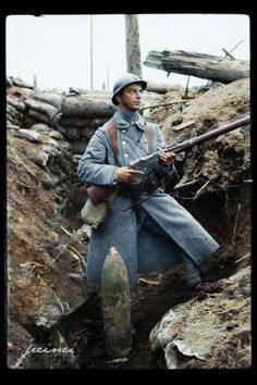 "A French ""poilu"" posing with his 8mm Lebel rifle. Colorized from a black-and-white original."