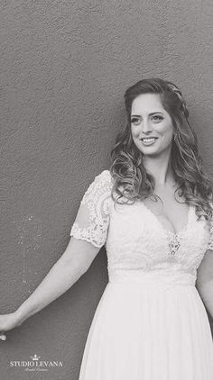 Real bride in a plus size wedding gown with short sleeves from Studio Levana #plussizeweddingdresses