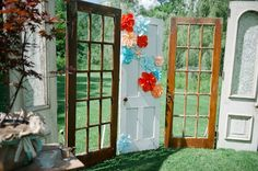 This couple repurposed old door frames to use as ceremony decor. Such a great idea!
