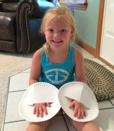Painting fingernails can be challenging when you kids are little. Try cutting a slit in a paper plate to slip their hands through. This way the polish won't get all over, and she has something to lay her hands on while they dry...