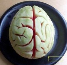 Halloween Party Food! Make this creepy watermelon brain. It's easy and your guests will love it! Cheap, fast, looks great! Spooky trick or treat display.