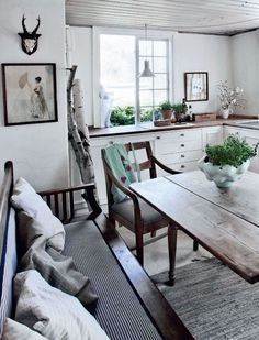 White, rustic, cozy kitchen.