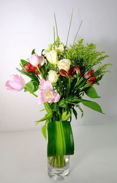 "Oberon is a beautiful and impressive arrangement with ballerina pink tulips, mellow yellow lisianthus combined of wine red blush lilies and fresh greens. This dazzling bouquet would be a perfect gift to say thank you, ""I'm thinking of you"" or get well soon. Vase Not Included. - See more at: http://www.timesflora.com/Oberon"