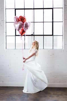 The heart balloons are so cute!  They would be the perfect addition for a wedding or bridal photo session. This was a spring Valentine's Day inspired shoot and we love how it turned out. My blonde hair had a fishtail braid and it was lightly curled to create the perfect boho-chic hairstyle. My makeup was more glamorous and the white dress would be so amazing for any bride! Check out more on my blog.