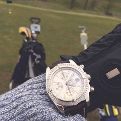 A game of #golf with the #Breitling Chronomat.
