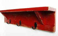 Wood wall shelf with hooks 24 inch rustic Coat Hanger Rack Cottage Shabby Chic CRANBERRY RED. $29.95, via Etsy.