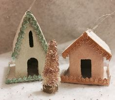 A personal favorite from my Etsy shop https://www.etsy.com/listing/254906589/vintage-style-christmas-putz-houses-pair