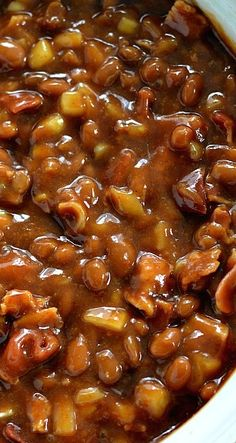 BBQ Baked Beans ~ Ingredients 2-28 oz. cans baked beans -- 1 lb. bacon, cooked and cut into 1 inch pieces -- 1 small sweet onion, chopped -- ½ cup brown sugar -- 1 cup barbecue sauce -- ½ cup yellow mustard -- ½ cup ketchup --