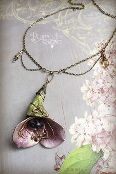 "Jewelry Pagan Wicca Witch:  ""Dreams in Amethyst,"" by plumevine, via Flickr. necklace with open flower"