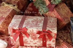 Use toile fabric to cover a gift box.