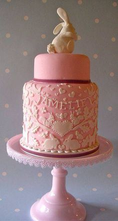 Pink Cake & white detail with bunny rabbit on top
