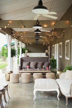 Neutral porch with pops of pink and outdoor lighting male this a fun spot!
