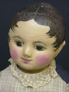 EARLY IZANNAH WALKER DOLL : Lot 171, looks repainted but still fun to see