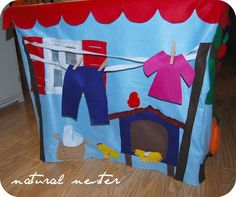 "Need an idea for the backside of the card table playhouse.I'm liking the clothes line! Could make the ""clothes"" pinnable on the line for baby funsies. Card Table Playhouse, Build A Playhouse, Girls Playhouse, Playhouse Ideas, Girls Tent, Tent Craft, Baby Tent, Table Tents, Sewing Cards"