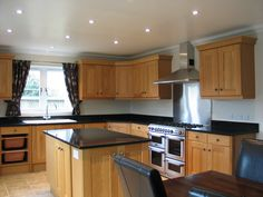 The Oak Kitchen with black granite worktops we fitted into one of the houses we built -by Regan & Regan