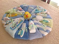 Diaper Cake Pizza Pie, Wash cloths, Pink Baby accessories, Baby shower gift,  Centerpiece, Blue Diaper Cake, Newborn Baby, New Mom, Boy, Gir by CreativeCraftRooms on Etsy https://www.etsy.com/listing/267777829/diaper-cake-pizza-pie-wash-cloths-pink