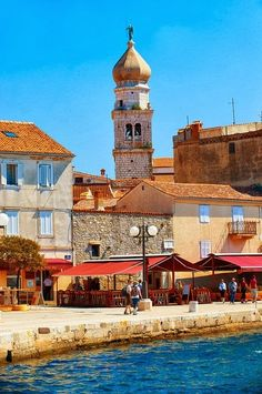 Port and 16th century Gothic styled bell tower topped with a 1767 Baroque dome of the Cathedral of Krk, Krk Island, Croatia