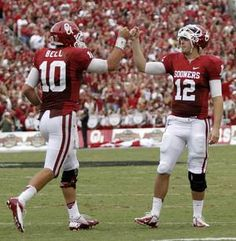 OU's Landry Jones (12) congratulates Blake Bell (10) after a touchdown during the Red River Rivalry college football game between the University of Oklahoma (OU) and the University of Texas (UT) at the Cotton Bowl in Dallas, Saturday, Oct. 13, 2012. Photo by Chris Landsberger, The Oklahoman