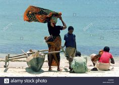 Pemba Family And Traditional Fishing Canoe On Beach In Pemba Stock Photo, Royalty Free Image: 14069150 - Alamy