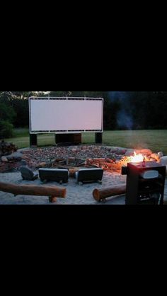 Old car seats, an outdoor movie screen made with PVC pipes, tethers & a white tarp.   Uhh this is perfect