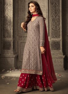 Red and Grey Embroidered Sharara Suit features a georgette kameez with santoon inner, georgette sharara with santoon inner and chiffon dupatta. Embroidery work is completed with thread work, lace and stone embellishments.