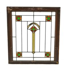 Early 20th century American craftsman style interior residential Chicago bungalow leaded art glass window with original pine darkly stained pine wood sash frame. #bungalow #stainedglass #artglass #pine #window #sashframe