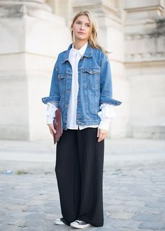 White shirt+black palazzo pants+black sneakers+denim jacket+brown clutch. Spring Casual Outfit 2017