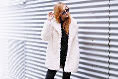 white fluffy coat / black