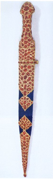 Not much is known about this golden dagger, which is encrusted in rubies. The total length of the dagger is 57 cm. (23 in.) and the largest rubies are approximately 10 cts.