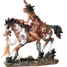 Estátua Indio em Seu Cavalo Guerreiro    Estátua indio em seu cavalo guerreiro. Muito indicado para amantes do estilo country e decoração de casas, haras e fazendas. Produto importado, de alta qualidade e fino acabamento. Feito e pintado a mão