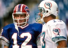 As the Bills prepare to play on the road against the Miami Dolphins, scroll through to view photos from previous matchups between the two opponents. Football Memes, Sport Football, Football Players, College Football, Miami Dolphins Quarterback, Miami Dolphins Game, Eric Moulds, Buffalo Bills Quarterbacks, School Sports
