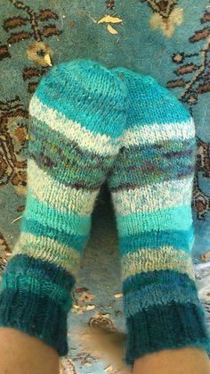 Handspun, handknit, handdyed great crazy socks.  Great for the holiday season