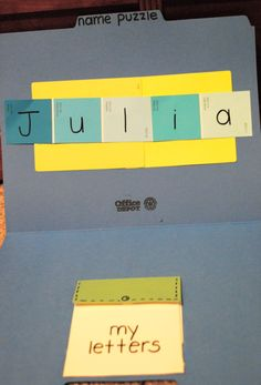 "Name puzzle - pocket made with paint chart samples & velcro dot to keep it closed. The pocket holds letters of the name on more paint samples. Match the pieces to the ones on the strip ("",)"