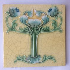 "ORIGINAL ART NOUVEAU EMBOSSED TILE 6""X 6"" C.1905 IN VERY GOOD CONDITION BUT FOR A FEW SMALL CHIPS, CRAZING.AND SOME CEMENT ON VERSO. 