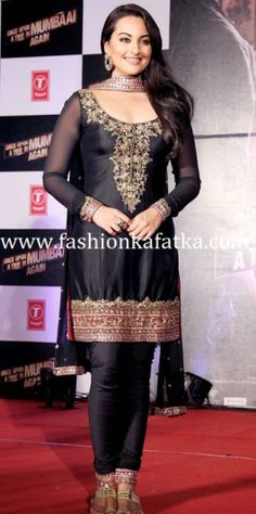 Sonakshi sinha in short length black color raw silk salwar kameez with rich embroidery work border,transparent full sleeves,embroidery work on the yoke,churidaar bottom and matching black dupatta