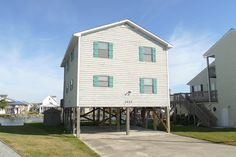 NEW LISTING in Surf City! 4BR, 2BA Canal Front home now for sale. Contact us for more information.