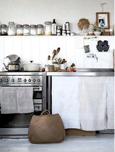 Stove, white curtain to hide appliances and shelf to hold all types of spices!